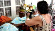 The Asian woman was sitting sewing. video