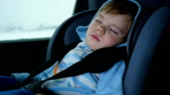 the baby is sleeping in the car in the way video