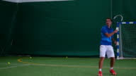 The ball is flying and tennis player beats it video