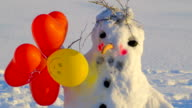 The balloons on the side of the snowman video
