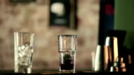 The bartender mixes mint leaves and berries. video