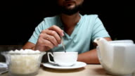 the bearded young man prevents the tea in a cafe video