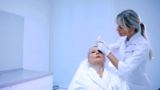 The beautician making injection in beauty clinic video