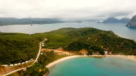 The beautiful bay with mountains rocks aerial view. Tropical islands video