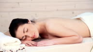 the beautiful girl lying in Spa massage therapist video