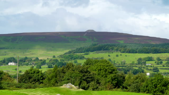 The big mountain behind the green pasture in Carrowmore Ireland video