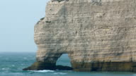 The big rock with small hole in the sea of Etretat video