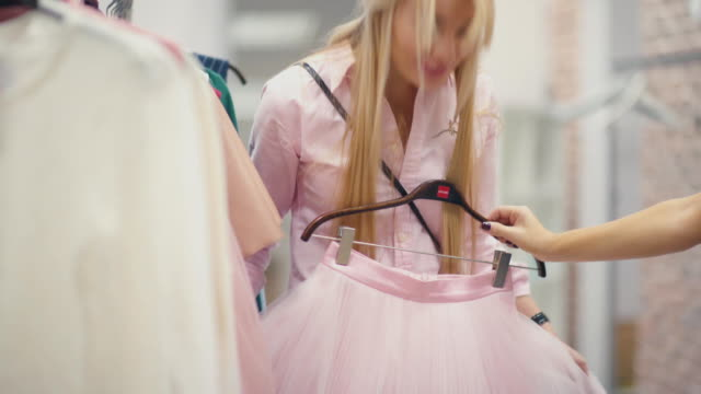 The blonde with long hair in a pink dress shopping with a friend video