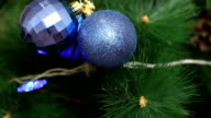 The blue ball is swinging on a Christmas tree. video