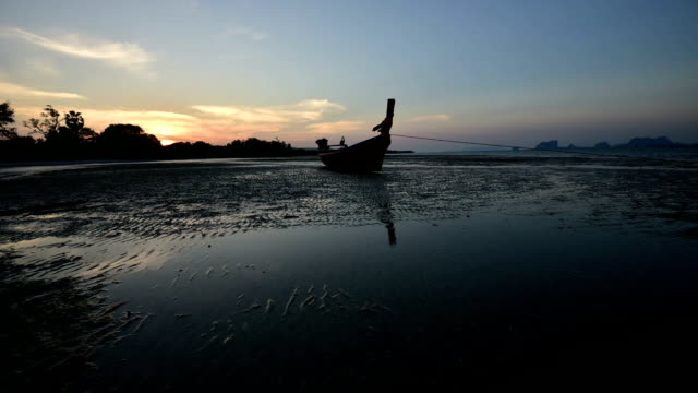 The boat and sand beach in the evening video