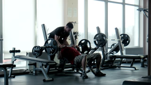 The bodybuilder does exercise with a bar video