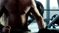 The bodybuilder does exercise with dumbbells video