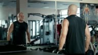 The bodybuilder does exercises for a biceps video
