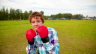 The boy in boxing gloves video