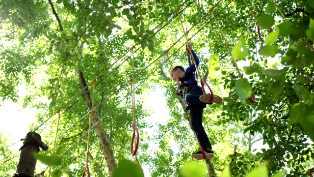 The boy overcomes the obstacle course. video