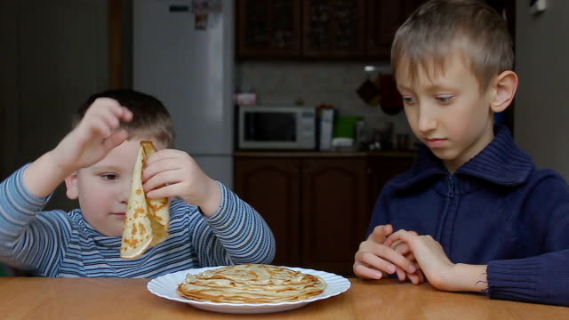 the boys start to eat pancakes video