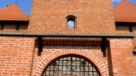 The brick wall of the old medieval castle in Lithuania video