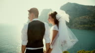 The bride and groom admiring the evening tide video
