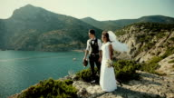 The bride and groom are standing on a cliff. Thirties. Vintage video