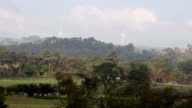 The British Countryside With Wind Turbine In The Distance video