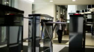 The businessman is passing through a turnstile. video