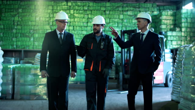 The businesspeople in warehouse video