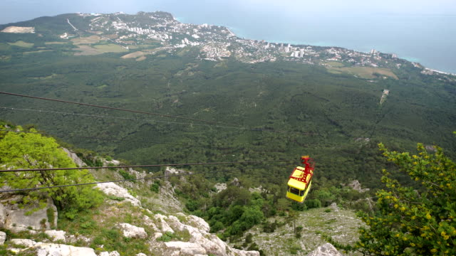 The cable car in Crimea Ai-Petri on a background of mountains covered with clouds video
