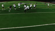 The camera pans overhead as a football player avoids being tackled and makes a touchdown video