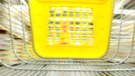 The cart in a supermarket. The movement between shelves with item. video