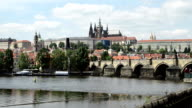 The Charles Bridge Crossing The Vltava River In Prague With St. Vitus Cathedral In The Background video