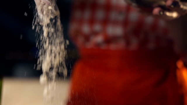The chef pours the flour for the dough. Slow motion video