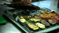 The chef prepared the fish and grilled vegetables. video