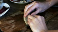 The chef removes the skin from fish for sushi video