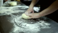 The chef rolls out the dough with a rolling pin video