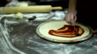 The chef smears ketchup on the dough video