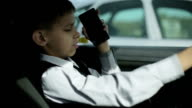 The child is driving. video