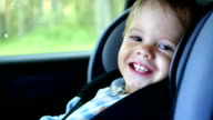 the child rides in the car and laughs video