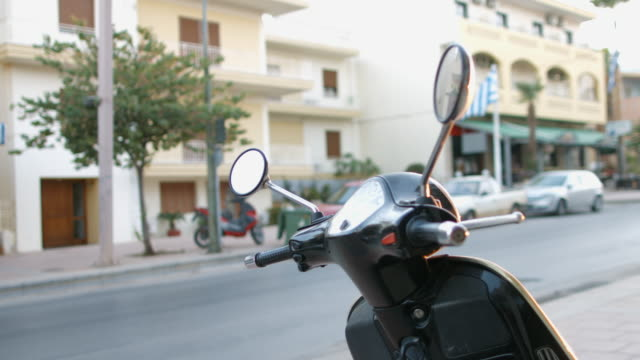 The city of Crete, Greece. Scooter on the background of the city video