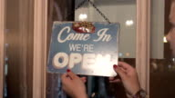 The closed and open sign on a glass door video