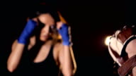 The close-up of the girl boxer hitting the focus mitts. 4K video