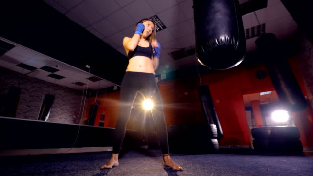 The close-up of the kickboxing girl. 4K video