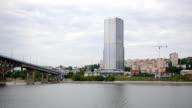 the coast, the city near the river bridge over sea water boating video