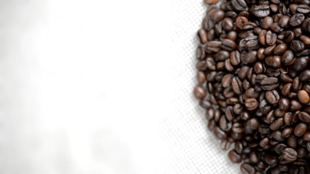 The coffee beans rotates on the turntable. video