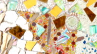 the colorful broken tile and stone decorating on temple wall video