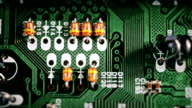 The components of the computer motherboard. The camera moves over the processor. Circuit works inside the chip. Closeup. video