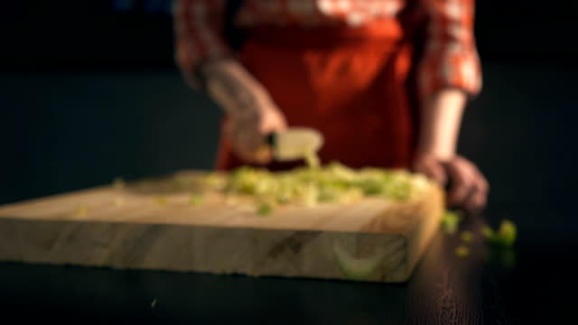 The cook cuts celery. Slow Motion video