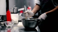 The cook prepares the dough of eggs and flour. video