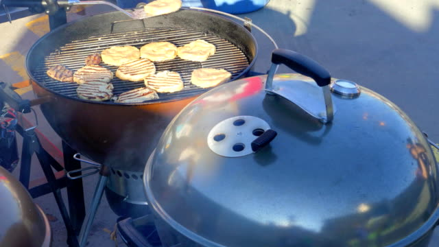The cook turns the meatballs into a grill video