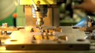 The drill bit rotates within the metal mold. Manufacture of molds video