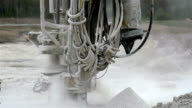 The dust seen from a drilling machine video